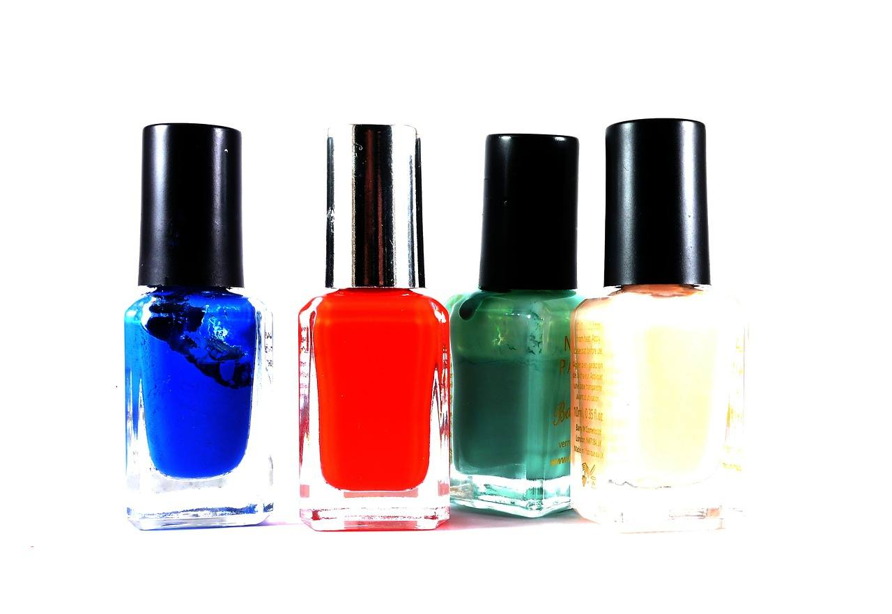 Blue, yellow, green and red nail polish